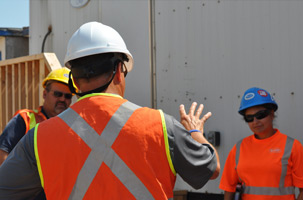 Supervisor talking to a worker
